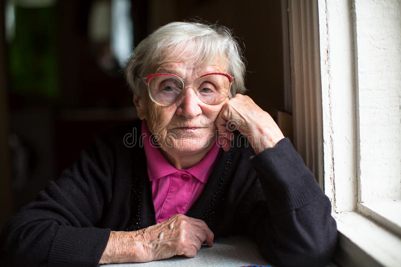 Portrait of elderly woman with glasses. Pensioner. royalty free stock image