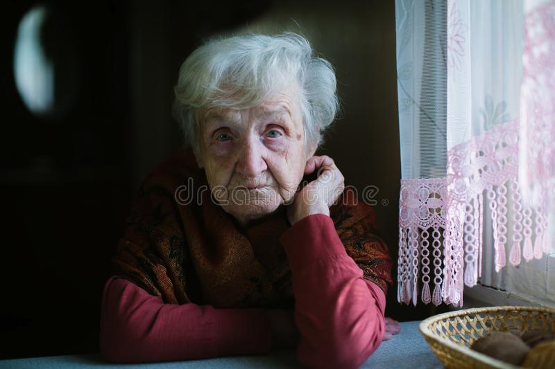 Elderly woman in her house. Ð¡are of seniors. Portrait of an elderly woman in her house. Ð¡are of seniors royalty free stock images