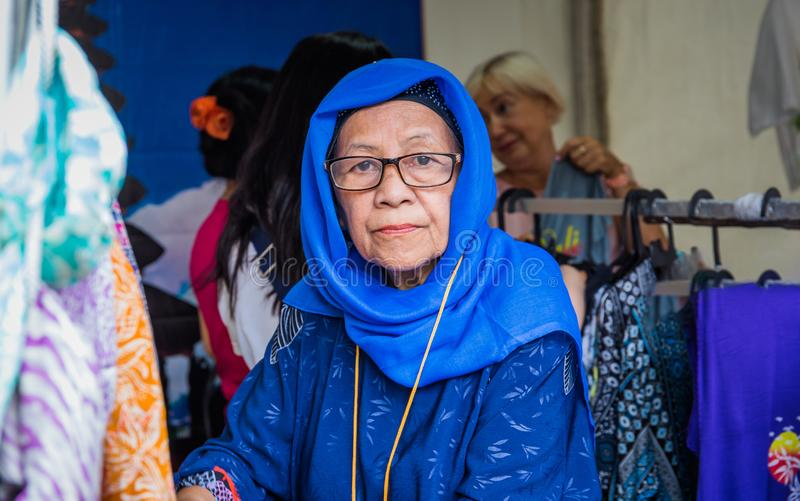 Moscow,Park on Krasnaya Presnya,August 05, 2018: Portrait of an elderly woman from Indonesia with glasses looking at the camera. stock photo