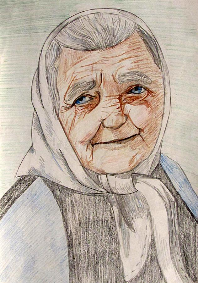 Portrait of an elderly woman in a kerchief with a smile on her face stock images