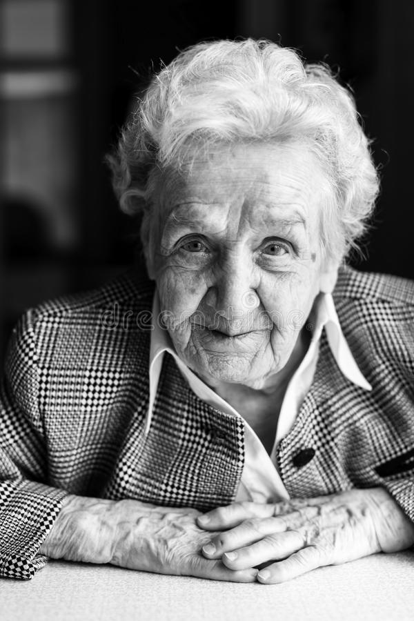 Portrait of an elderly woman looking into camera stock image