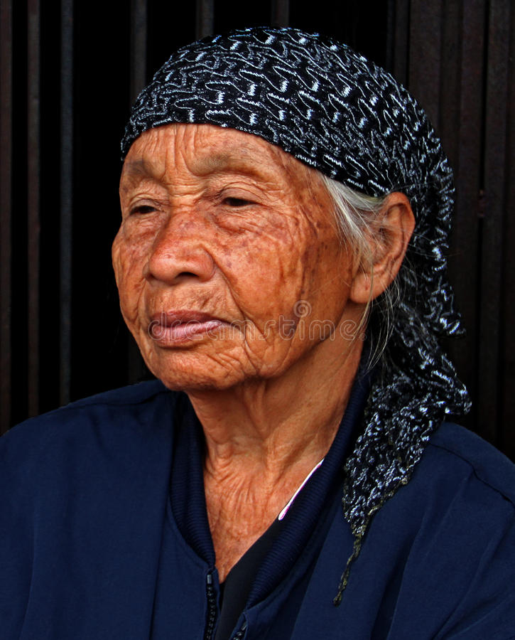 PORTRAIT OF ELDERLY WOMAN IN PADANG CITY INDONESIA royalty free stock photography