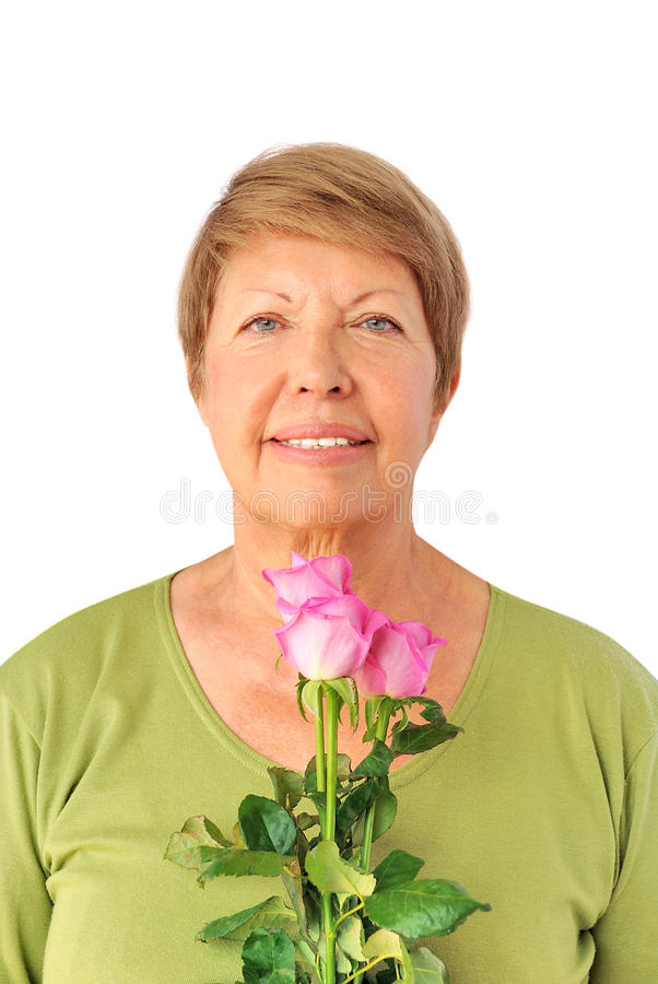 Portrait of elderly woman with pink roses. On the white background royalty free stock images