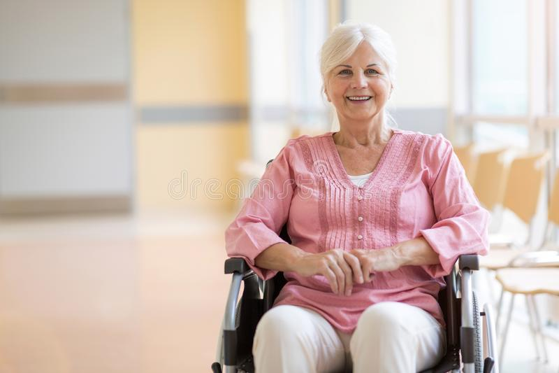 Senior woman on wheelchair in hospital stock image