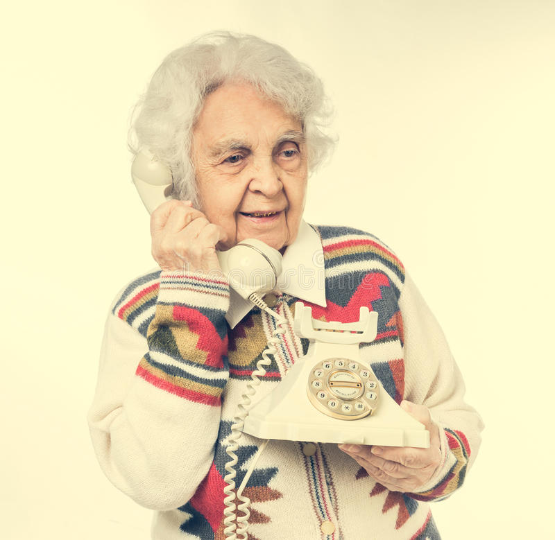 Portrait of elderly woman talking on the phone stock images