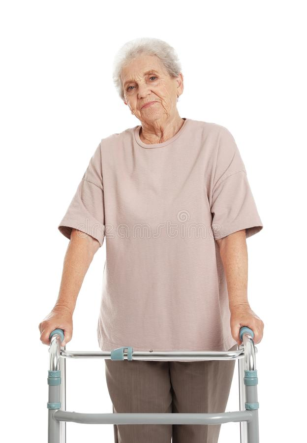 Portrait of elderly woman using walking frame isolated stock photography