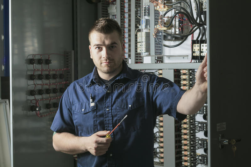 Portrait of an electrician in a room royalty free stock image
