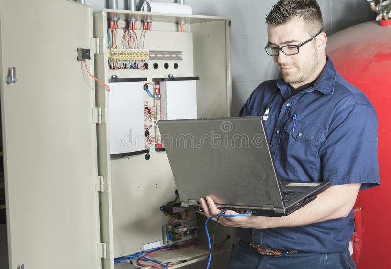 Portrait of an electrician in a room stock images