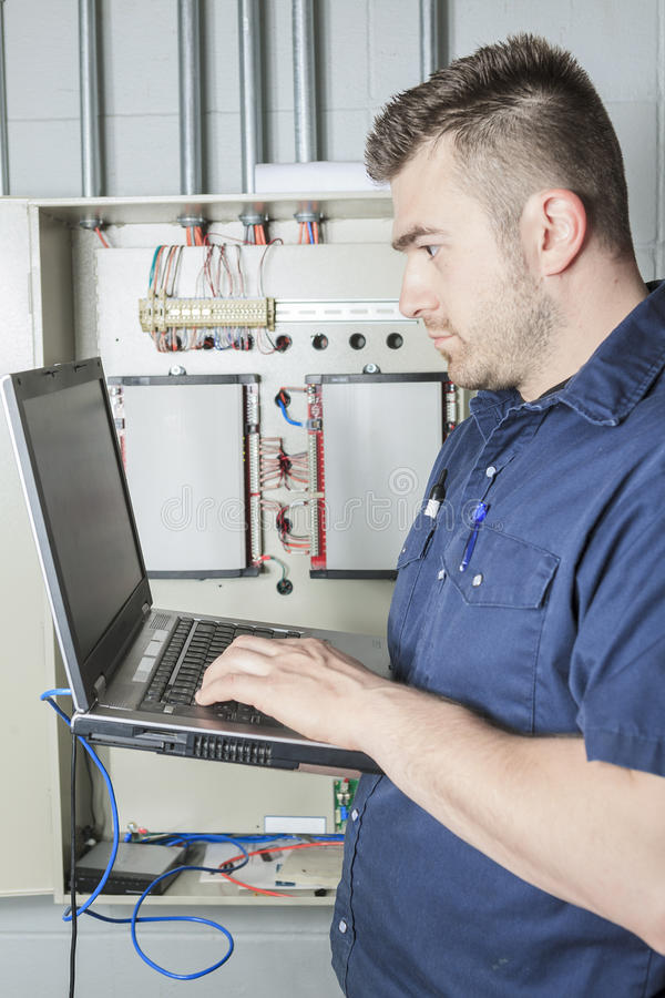 Portrait of an electrician in a room stock image