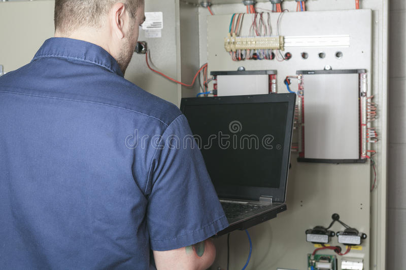 Portrait of an electrician in a room stock photo