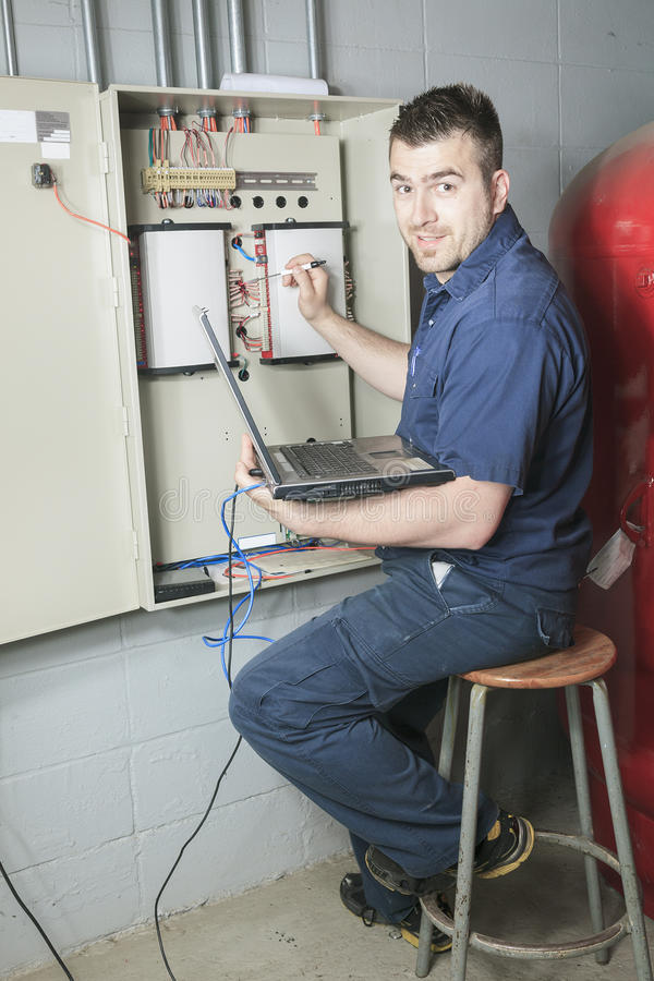 Portrait of an electrician in a room royalty free stock photo