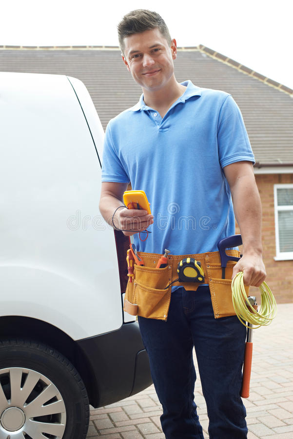 Portrait Of Electrician With Van Outside House royalty free stock image