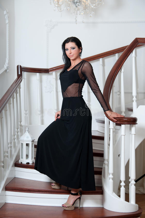 Portrait of elegance woman on steps. Black dress royalty free stock photography