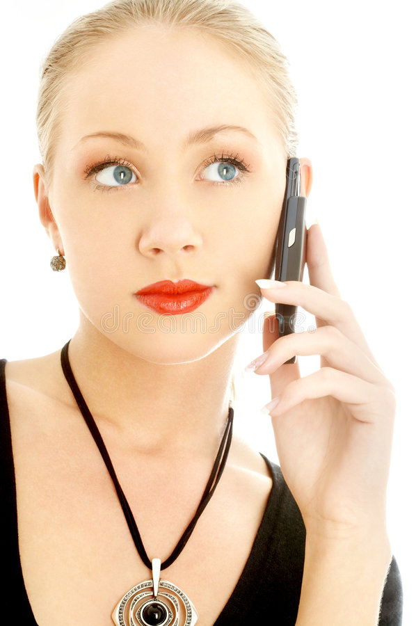 Portrait of elegant blond using cellular phone. Over white royalty free stock photos