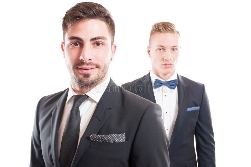 Portrait of elegant business men wearing necktie and bowtie stock photo