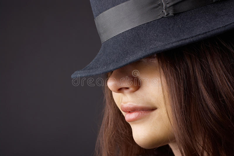 Portrait of elegant fashionable woman. In hat stock photography