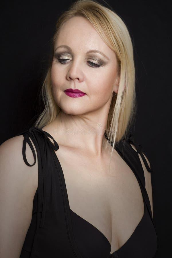 Portrait of elegant mature woman in black dress. stock photos
