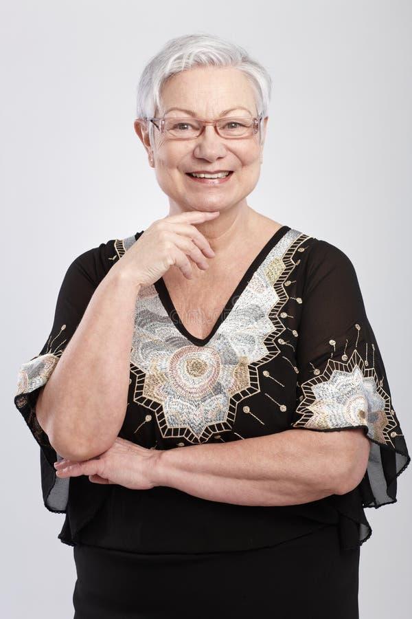 Portrait of elegant old lady smiling royalty free stock image