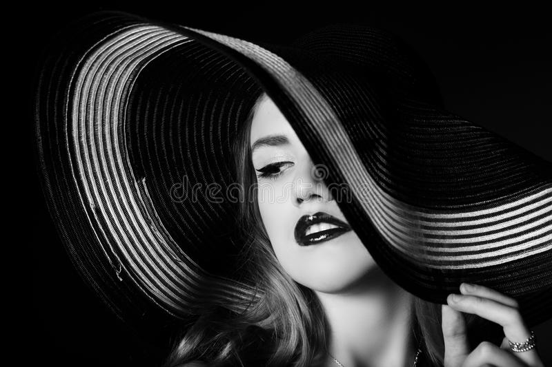 Portrait of elegant woman in black and white hat. stock photo