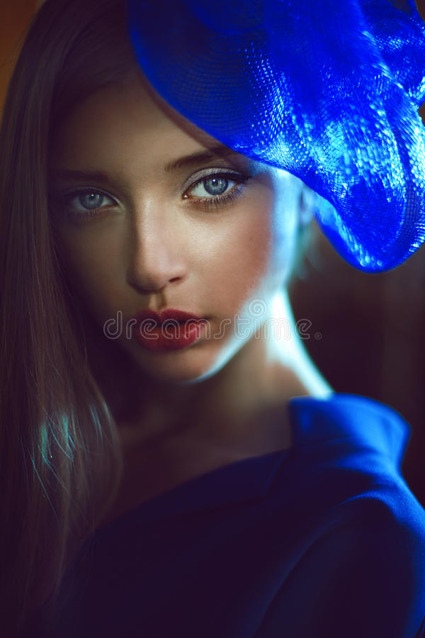 Portrait of elegant woman with blue hat in navy dress stock photos