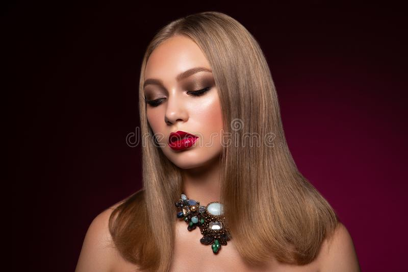 Portrait of elegant woman with red lips stock photography