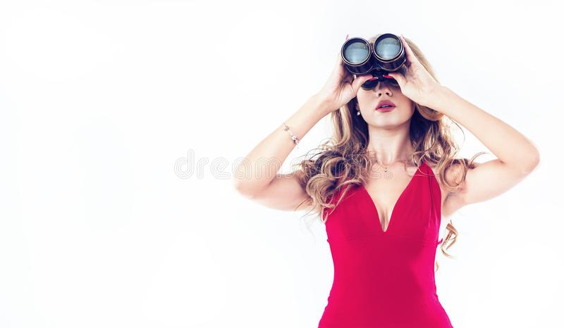 Portrait of an elegant lady using binoculars - isolated royalty free stock photography