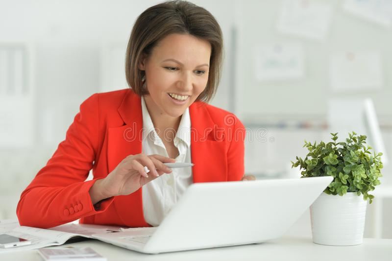 Portrait of a beautiful young woman working stock photo
