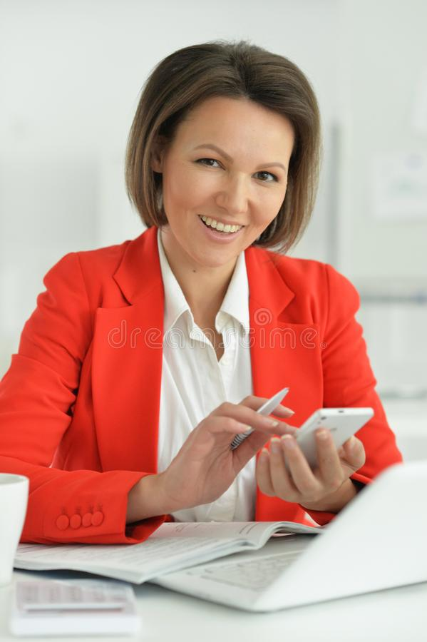 Portrait of a beautiful young woman working royalty free stock photo