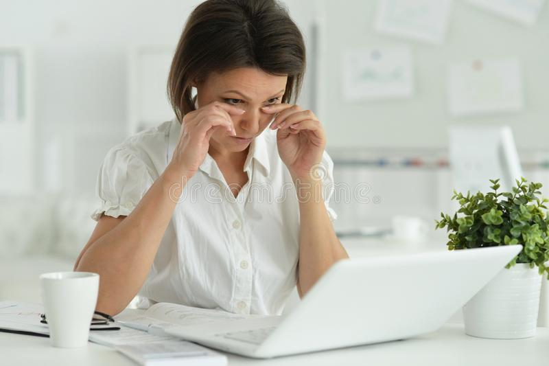 Portrait of a beautiful young woman working stock photography