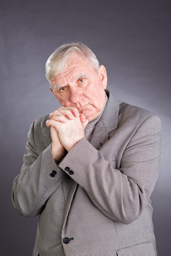 Portrait emotional elderly men. On a grey background royalty free stock photos