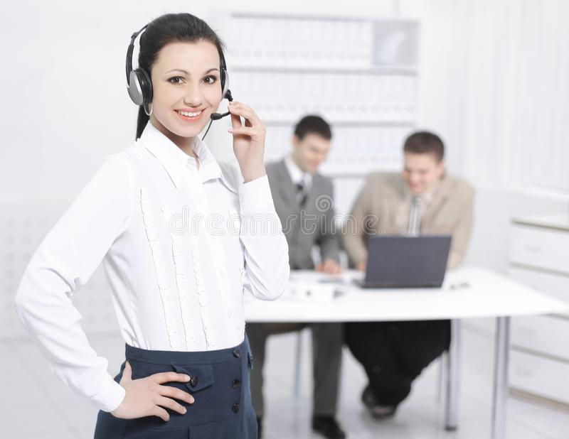 Portrait of an employee call center in the background of the of royalty free stock images