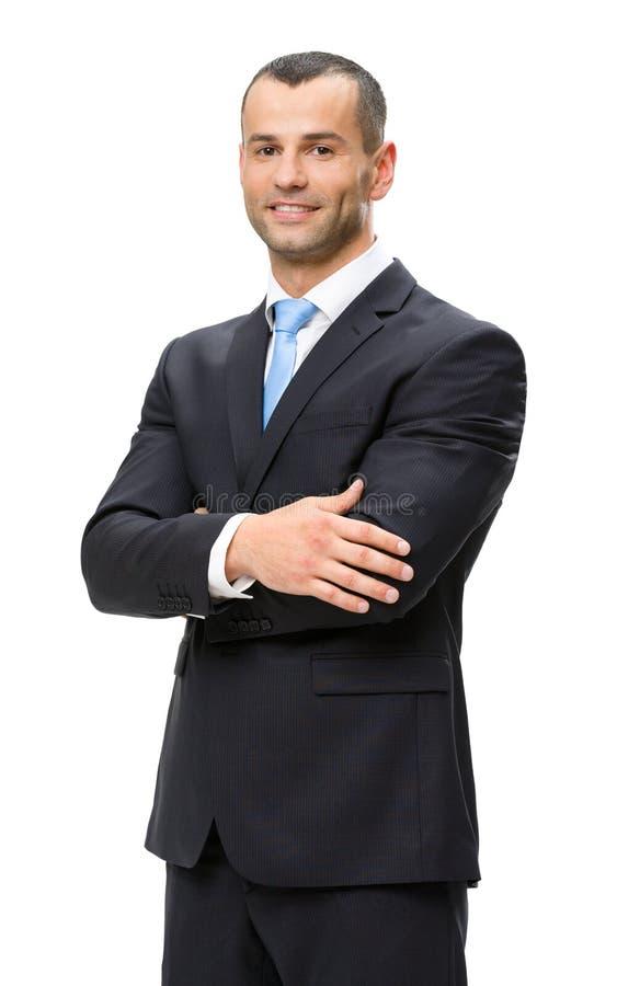 Portrait en buste d'homme d'affaires avec des mains croisées photographie stock
