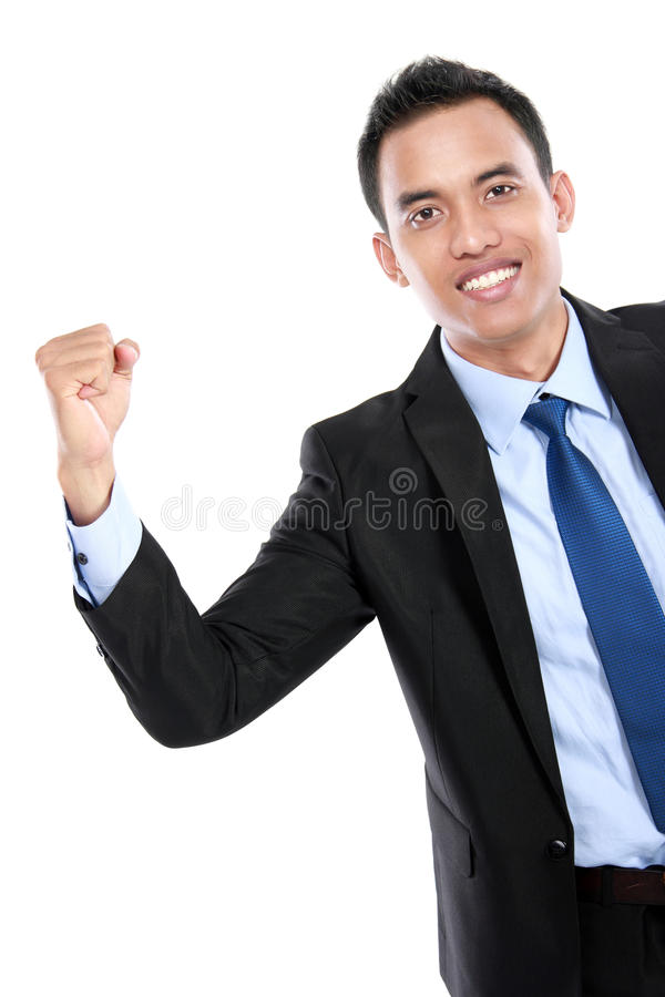 Portrait of a energetic young business man enjoying success royalty free stock photo