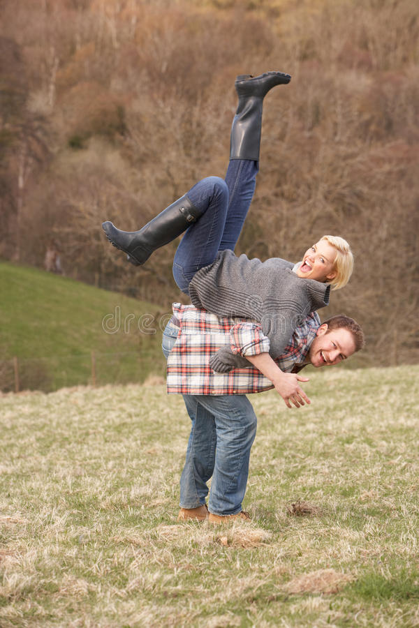 Portrait Of Energetic Young Couple Having Fun stock image