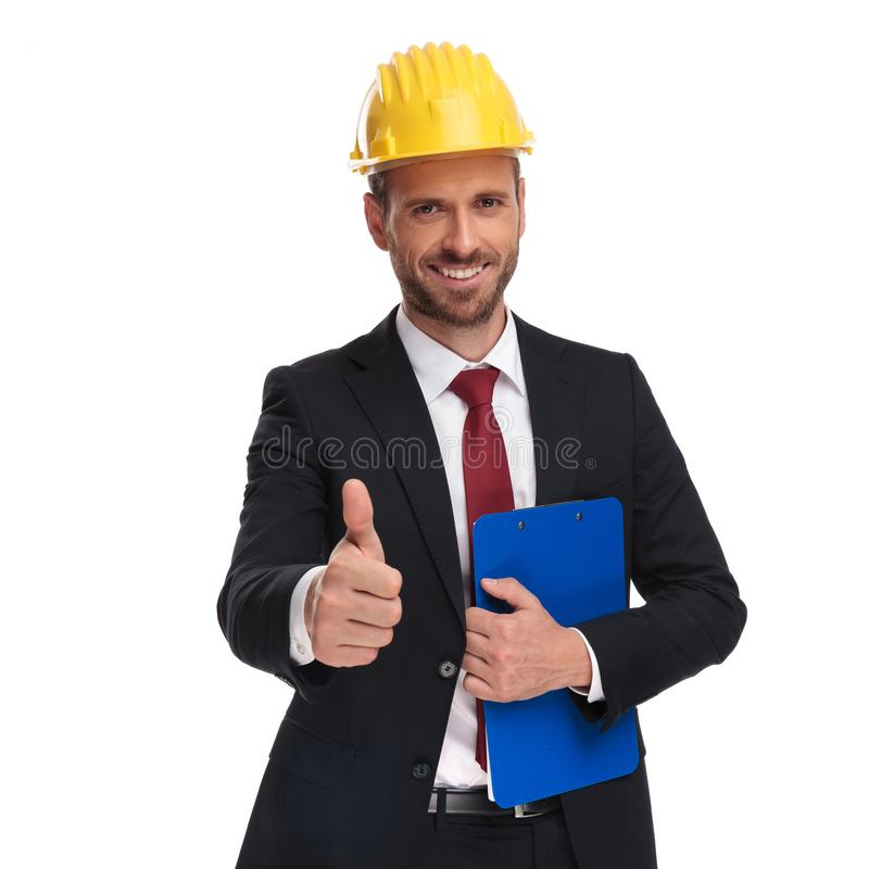 Portrait of engineer boss with blue folder making ok sign royalty free stock photo