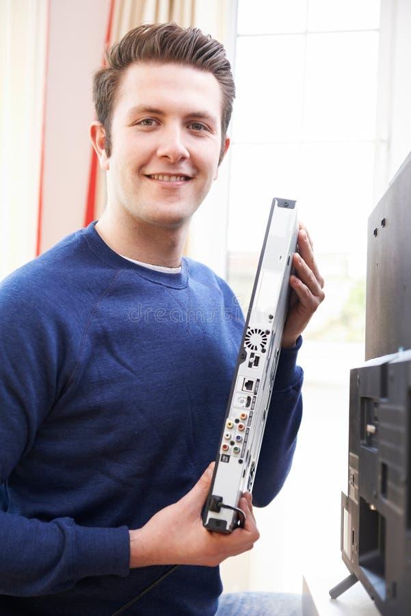 Portrait Of Engineer Installing Digital TV Equipment royalty free stock image