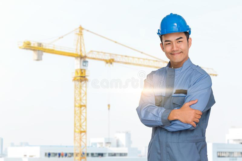 Portrait of engineer wear blue helmet saefty on construction site with crane background stock photo
