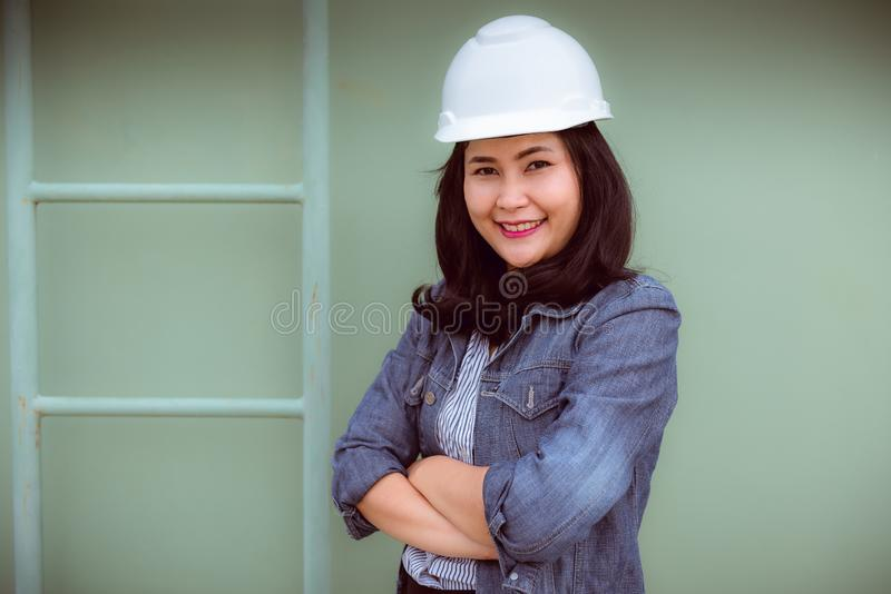 Portrait of engineer woman standing beside ladder in construction site royalty free stock photo