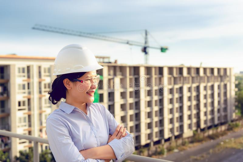 Portrait of engineer woman supervising civil construction work royalty free stock images