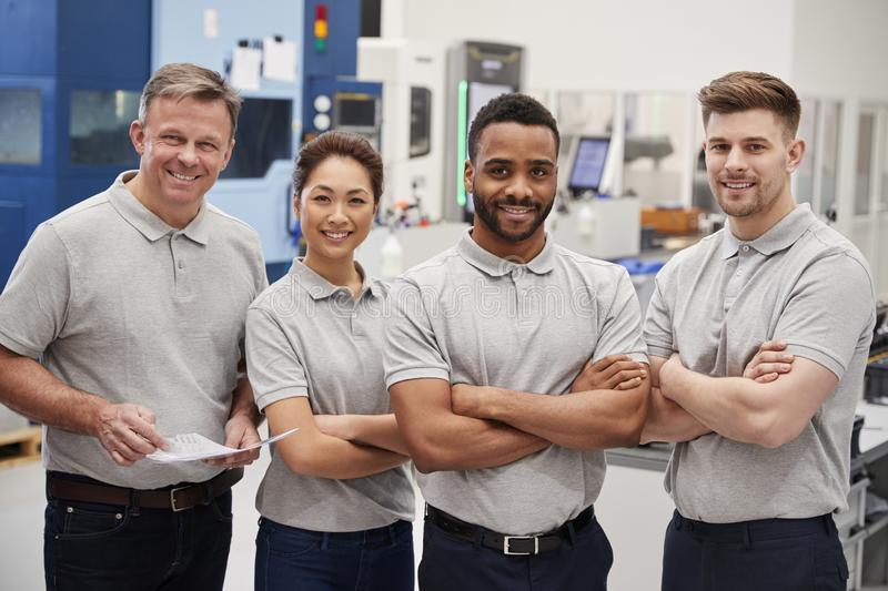 Portrait Of Engineering Team On Factory Floor Of Busy Workshop royalty free stock photography