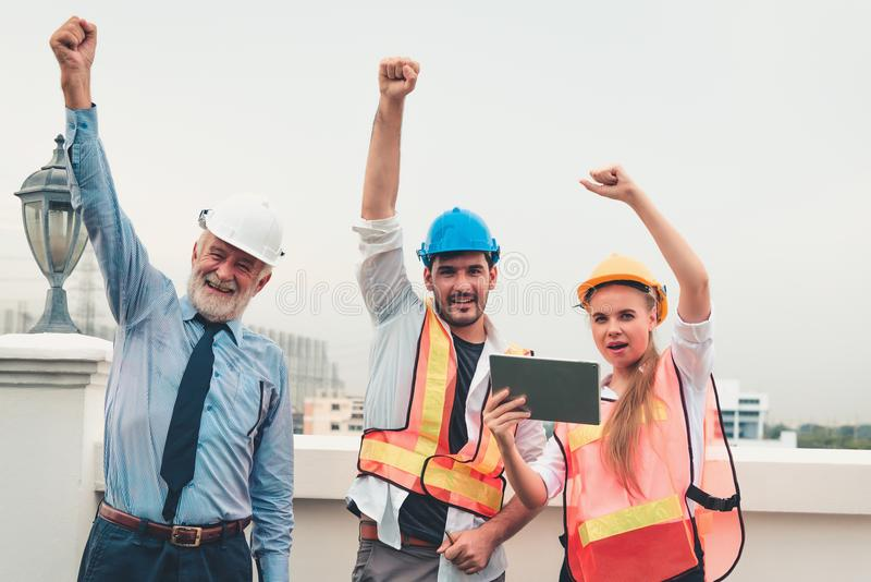 Portrait of engineering teamwork are showing hands up after business successful, Construction teamwork concept royalty free stock photography