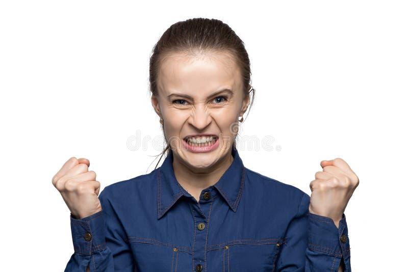 Portrait of enraged girl. Portrait of enraged woman on white background royalty free stock photo
