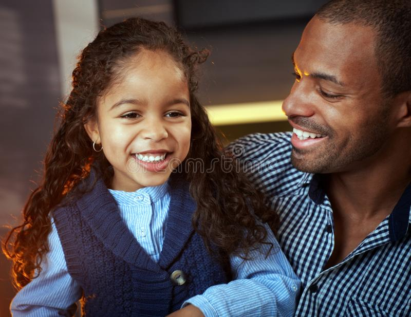 Portrait of ethnic father and cute little daughter stock images