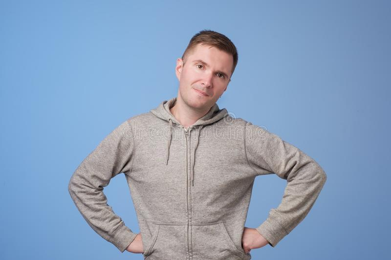 Portrait of european handsome man looking suspicious. He does not really believe in the words he hears stock photo