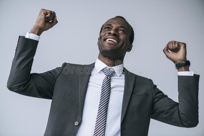 portrait of excited african american businessman looking away stock images