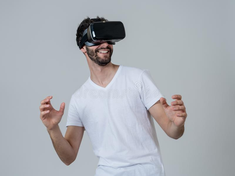 Portrait of excited and amazed young man wearing Virtual Reality headset exploring 3D world royalty free stock photography