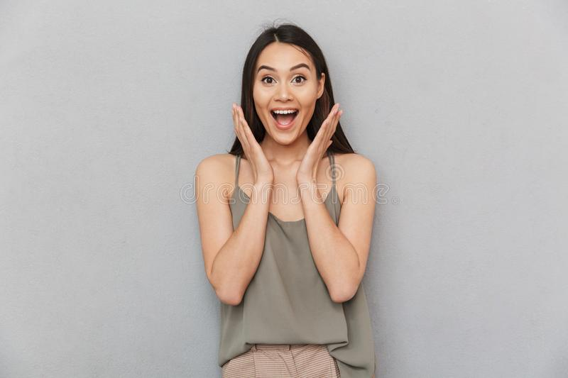 Portrait of an excited asian woman looking at camera royalty free stock image