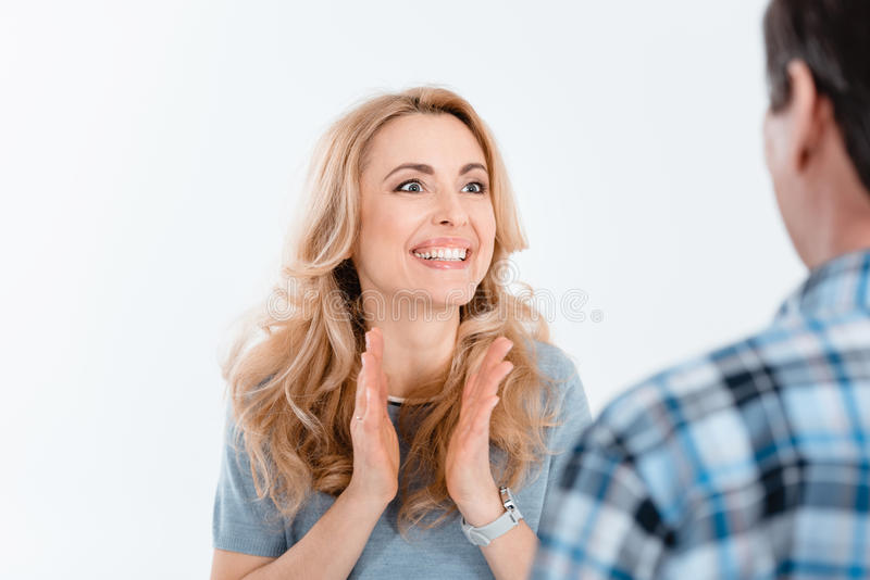 Portrait of excited attractive woman looking on man royalty free stock photography