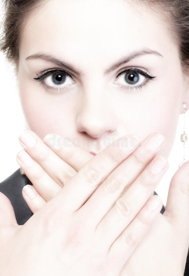 Portrait of excited business woman covering her mouth by the han