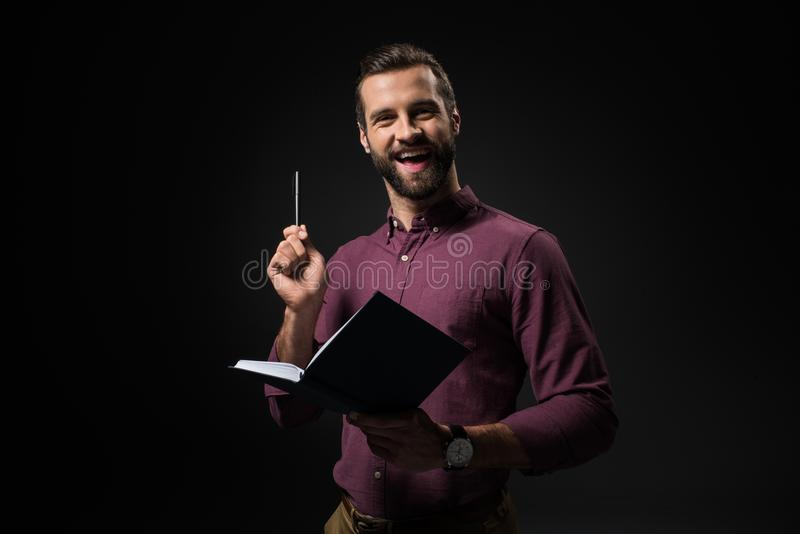 portrait of excited businessman with notebook stock photos